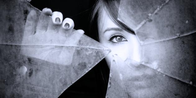 woman-looking-thru-broken-glass-e1432812808280-630x317