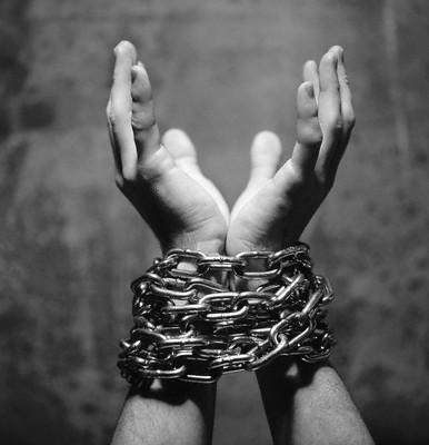 Wrists Tied in Chains --- Image by © Royalty-Free/Corbis